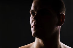Dark portrait of strong athletic man Royalty Free Stock Photo