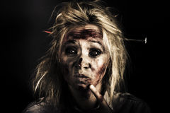 Evil Dead Female Zombie With Monster Headache. Dark Portrait Of A Undead Woman Thinking Of A Solution To A Killer Migraine When Stuck With A Stake Headache Stock Image