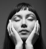 Dark portrait of a young woman with closed eyes. Sensual dark portrait of a young woman with closed eyesrr Stock Photography
