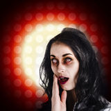 Dark portrait of a zombie girl in shock horror Royalty Free Stock Images
