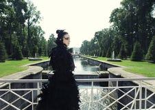 Dark princess on the bridge. Royalty Free Stock Photography