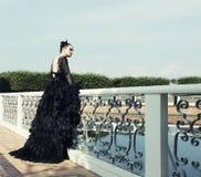 Dark princess on the bridge. Stock Image