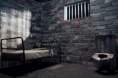 Dark prison cell at night Stock Photo