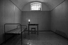 Dark prison cell in Peter and Paul fortress Stock Photos