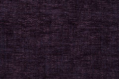 Dark purple background of soft, fleecy cloth. Texture of textile closeup Stock Photo