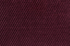 Dark purple background from soft fleecy fabric closeup. Texture of textile macro Royalty Free Stock Image