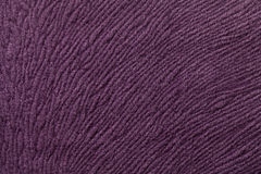 Dark purple background from soft textile material. Fabric with natural texture. Royalty Free Stock Image