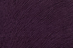 Dark purple background from soft textile material. Fabric with natural texture. Stock Image