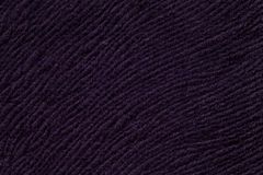 Dark purple background from soft textile material. Fabric with natural texture. Stock Photo