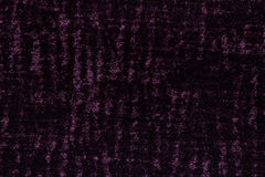 Dark purple background from a soft textile material. sheathing fabric with natural texture. Stock Photo