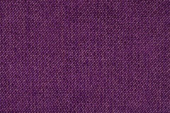 Dark purple background from woolen texture textile, closeup. Structure of the wicker fabric macro. Royalty Free Stock Images