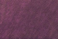 Dark purple and brown background of felt fabric. Texture of woolen textile stock images