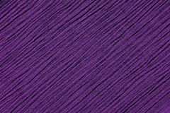 Dark purple crinkled fabric background texture. Dark purple crinkled fabric with irregular diagonal lines textile abstract background texture Royalty Free Stock Image
