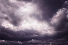 Dark purple dangerous stormy dramatic cloudscape Stock Image