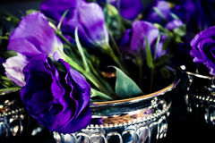 Dark Purple Lisianthus Flowers. Placed in chrome antique bowls. Flower decorations for a wedding Stock Photos