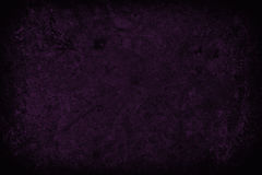 Dark purple scratched grunge wall background or texture Royalty Free Stock Image
