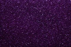 Dark purple sparkling background from small sequins, closeup. Brilliant shiny backdrop from textile. royalty free stock photos