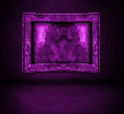 Dark purple wall with frame and floor interior Stock Photography