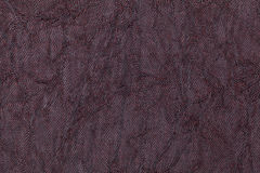 Dark purple wavy background from a textile material. Fabric with natural texture closeup. Upholstery fabric pleated stock photos
