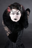 The Dark Queen. Woman dressed up in gothic style as dark queen in ancient victorian clothing Stock Photography