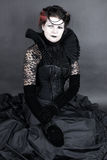 The Dark Queen. Woman dressed up in gothic style as dark queen in ancient victorian clothing Stock Photo