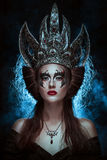 Dark queen. Elegant queen female face with red lips and black eye makeup Royalty Free Stock Photo