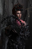 Dark queen in black fantasy costume. On dark gothic background Royalty Free Stock Images