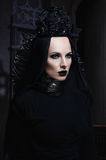 Dark queen in black fantasy costume. On dark gothic background Royalty Free Stock Photography