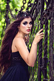 Dark queen with a crown in the park Royalty Free Stock Photo