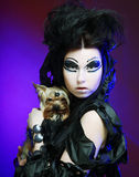 Dark queen with little dog Stock Image