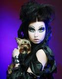 Dark queen with little dog Stock Image