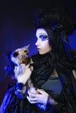 Dark queen with little dog Stock Photo