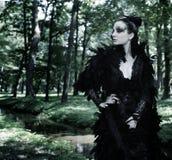 Dark Queen in park Stock Image