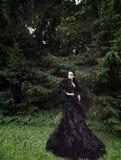 Dark Queen in park Royalty Free Stock Image