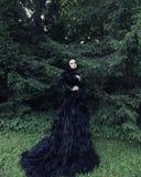 Dark Queen in park Stock Photo