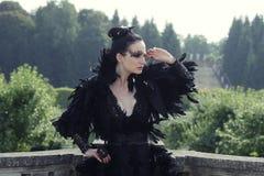 Dark Queen in park Royalty Free Stock Photo