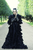 Dark Queen in park. Fantasy black dress Stock Photos