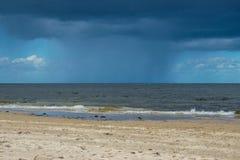 Dark rain clouds above the Baltic sea. Raining stock image