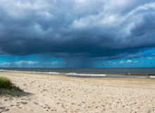 Dark rain clouds above the Baltic sea. Raining royalty free stock photography