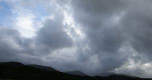 Dark rain clouds over Scottish hills stock video
