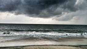 Dark rain clouds over sea Stock Photography