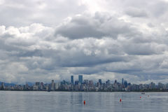 Dark Rain Clouds Over Vancouver. Dark, heavy and ominous rain clouds hang above the city of Vancouver, British Columbia royalty free stock images