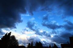 Dark rain clouds in the sky. Dark storm clouds gather over a city. Dark rain clouds in the sky stock photos