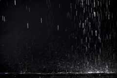 Dark rain. Rain shower against black background royalty free stock images