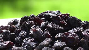 Dark raisin largely. Healthy food. Dried fruits. Movement in a circle. 4K. stock footage