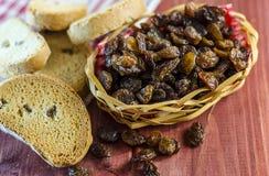 Dark raisins and crackers Stock Photography