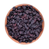Dark raisins in a wooden bowl Royalty Free Stock Photo
