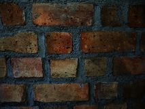 Dark real brick wall texture background Stock Image