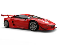 Dark red awesome race car - side view. Isolated on white background stock image