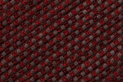 Dark red background from checkered pattern textile, closeup. Structure of the wicker fabric macro. Stock Photo